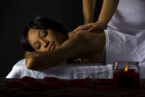 Woman receiving massage.
